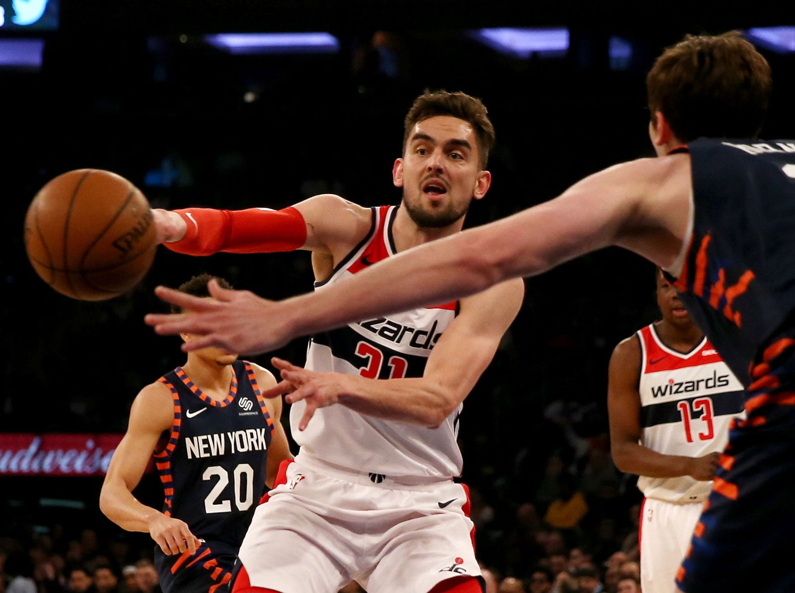 Tomas Satoransky #31 of the Washington Wizards passes the ball as Mario Hezonja #8 of the New York Knicks defends at Madison Square Garden on April 07, 2019 in New York City.