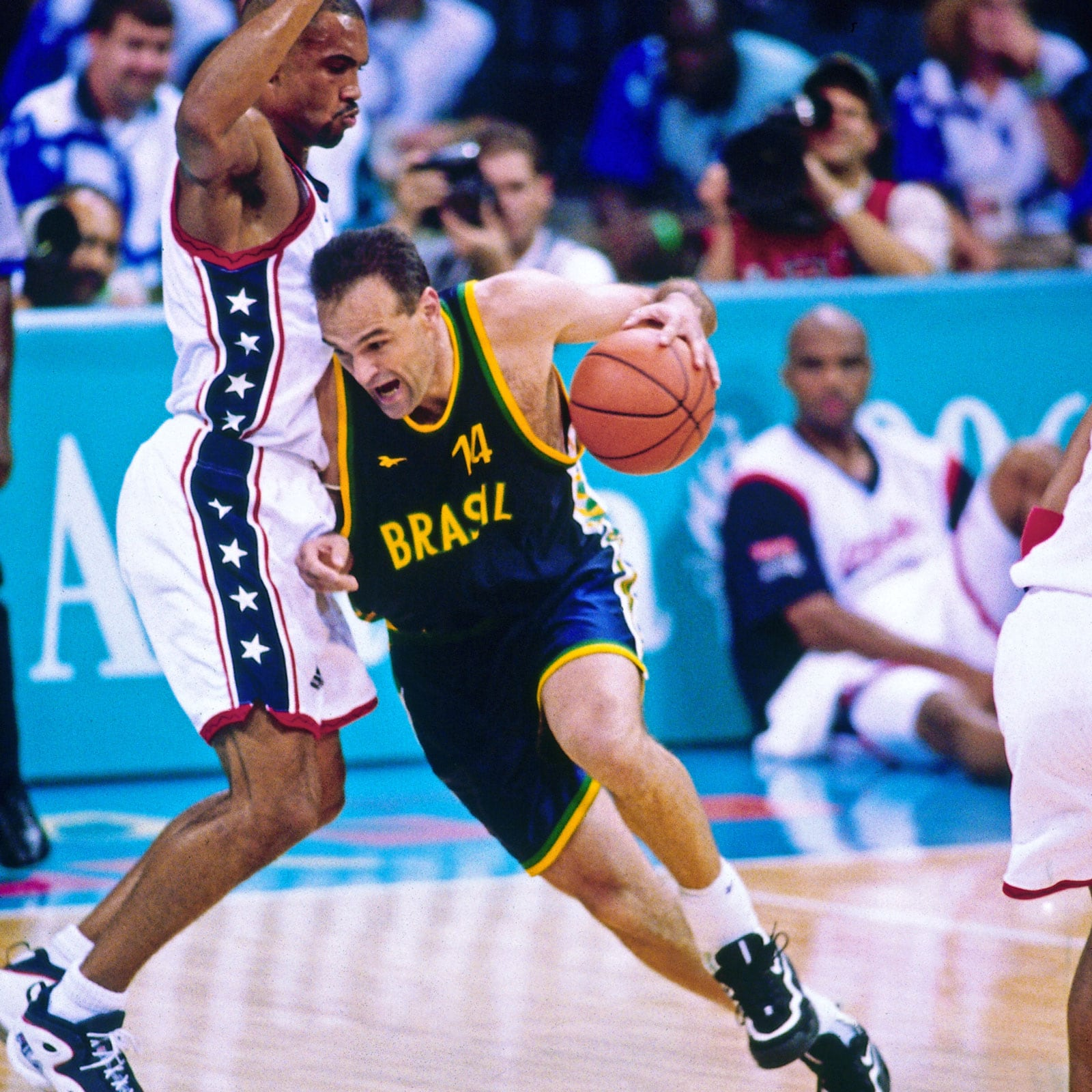 Oscar Schmidt #14 of Brazil drives against the United States during the 1996 Summer Olympics at Morehouse College Gymnasium on July 30, 1996 in Atlanta, Georgia.