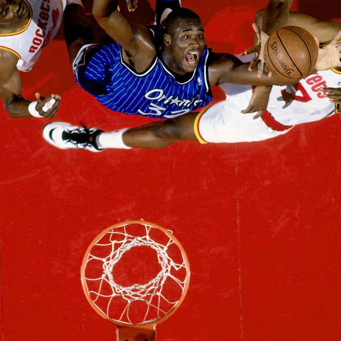 Shaquille O'Neal #32 of the Orlando Magic grabs a rebound against Hakeem Olajuwon #34 of the Houston Rockets in Game Four of the 1995 NBA Finals played June 14, 1995 at the Summit in Houston, Texas. The Rockets won 113-101.