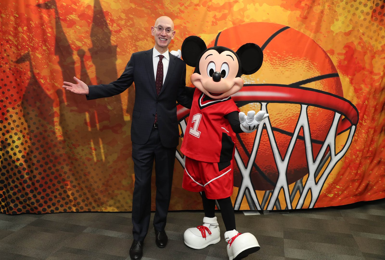 NBA Commissioner, Adam Silver and Mickey Mouse meet during NBA All Star Weekend in Charlotte, North Carolina on February 15, 2019 at Bojangles Coliseum.