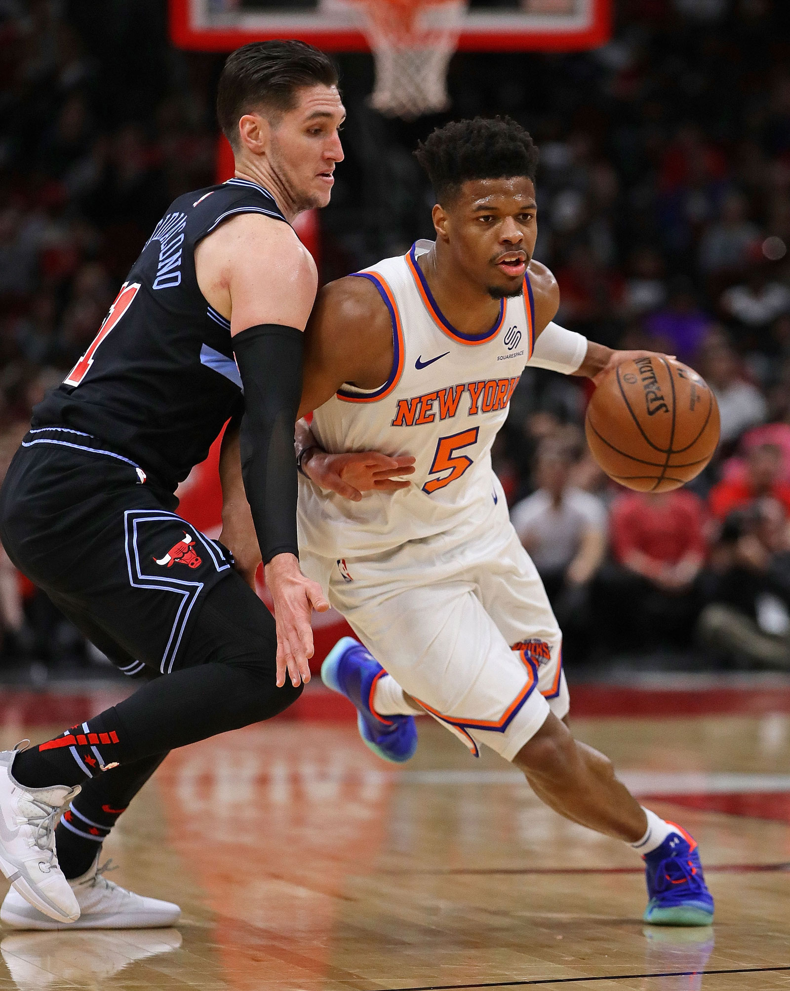 Dennis Smith Jr. #5 of the New York Knicksdrives against Ryan Arcidiacono #51 of the Chicago Bulls at the United Center on April 09, 2019 in Chicago, Illinois.