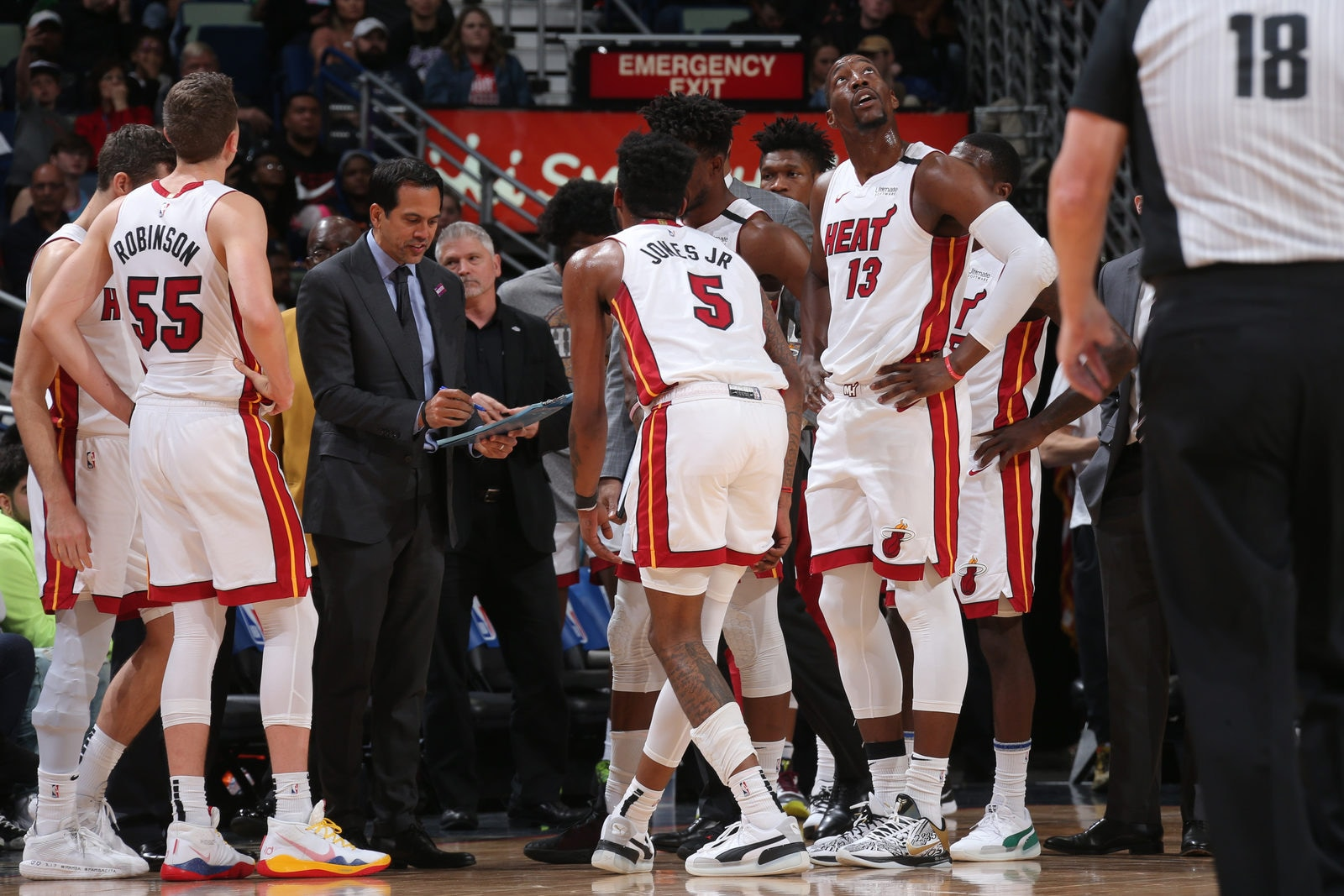 Erik Spoelstra of the Miami Heat draws up a play in the huddle during the game on March 6, 2020 at the Smoothie King Center in New Orleans, Louisiana