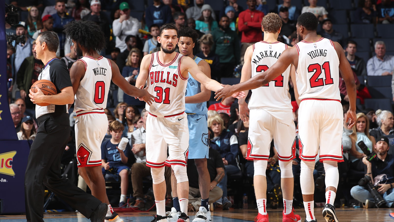 Bulls team come together during play