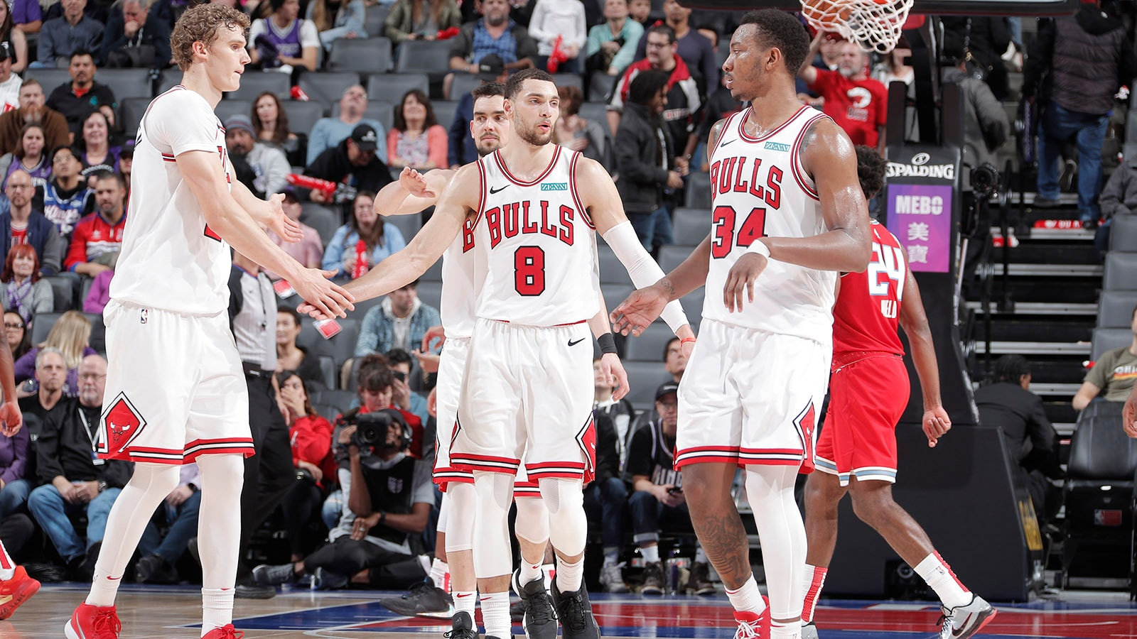 Zach LaVine high fiving teammates
