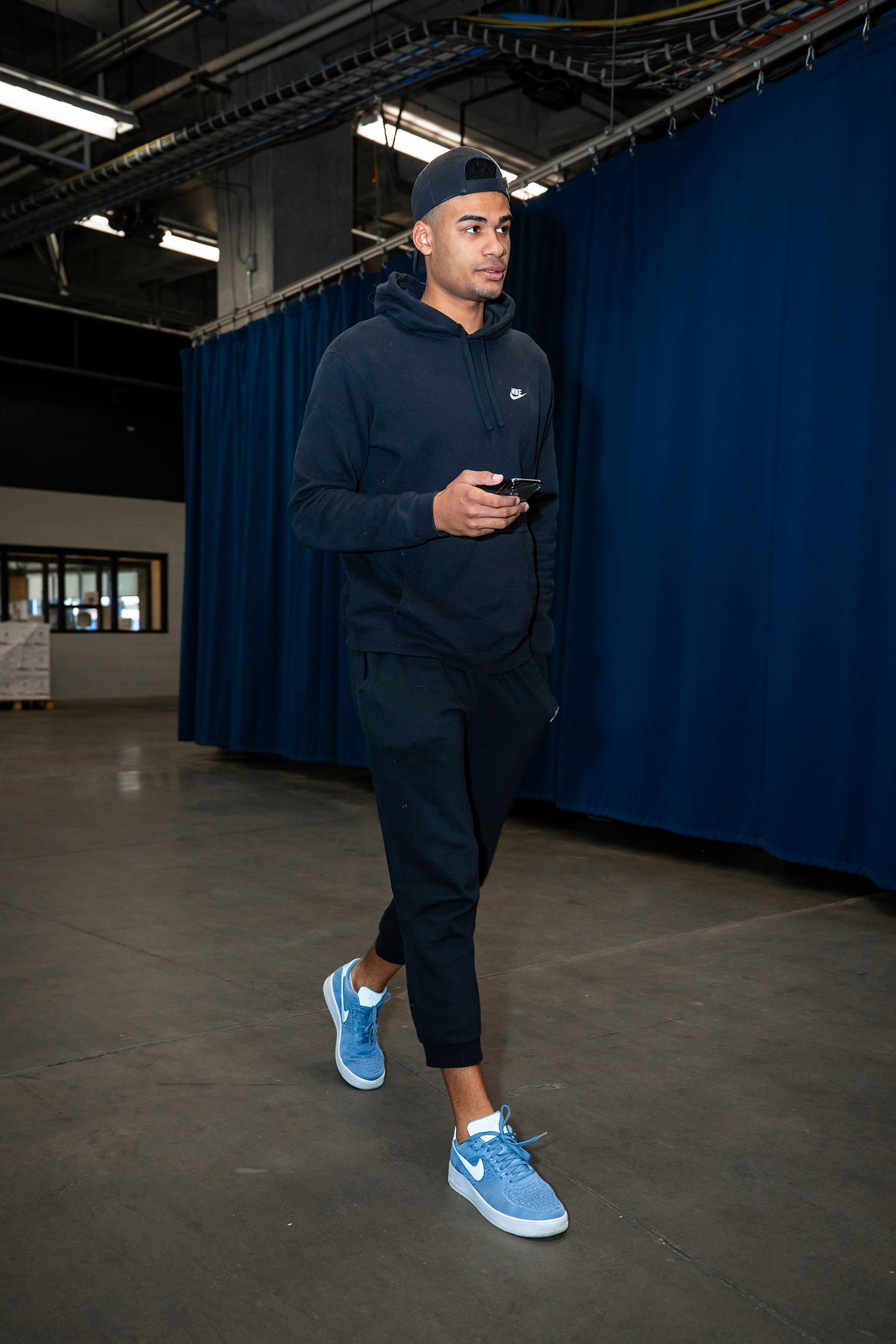 Timothe Luwawu-Cabarrot walking into an arena in street clothes