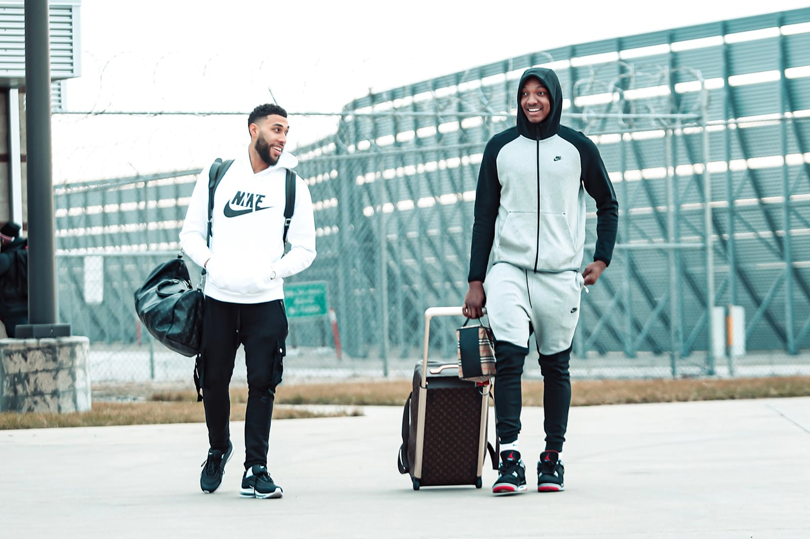 Denzel and Wendell boarding the plane for a team trip