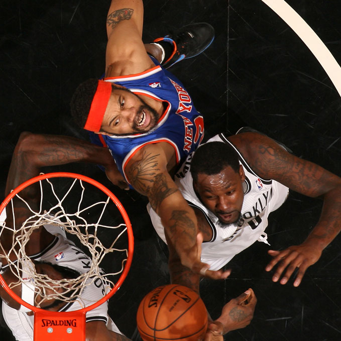 Rasheed Wallace #36 of the New York Knicks grabs a rebound against the Brooklyn Nets on December 11, 2012 at the Barclays Center in the Brooklyn borough of New York City.