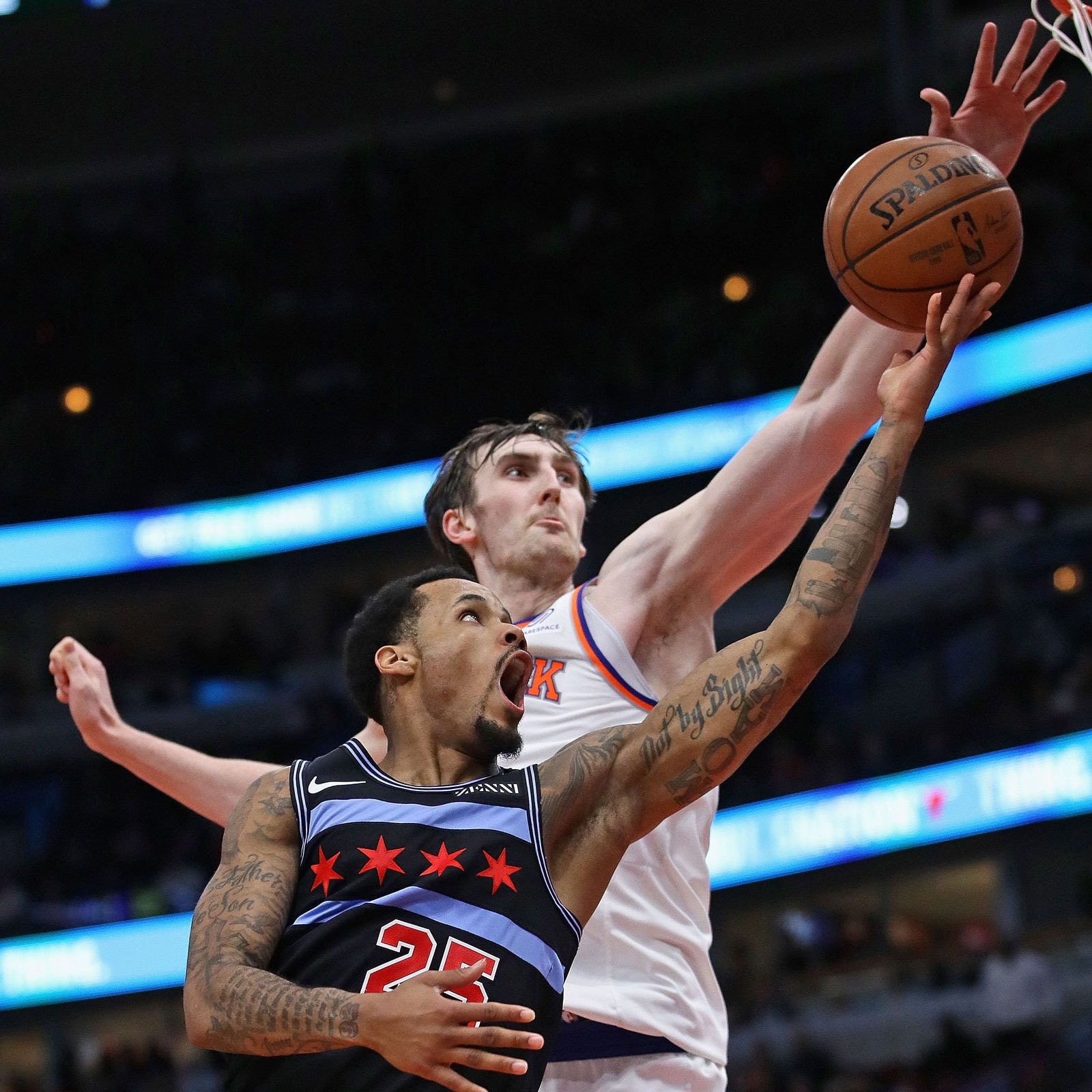 Walt Lemon Jr. #25 of the Chicago Bulls drives to the basket against Luke Kornet #2 of the New York Knicks at the United Center on April 09, 2019 in Chicago, Illinois. The Knicks defeated the Bulls 96-86.