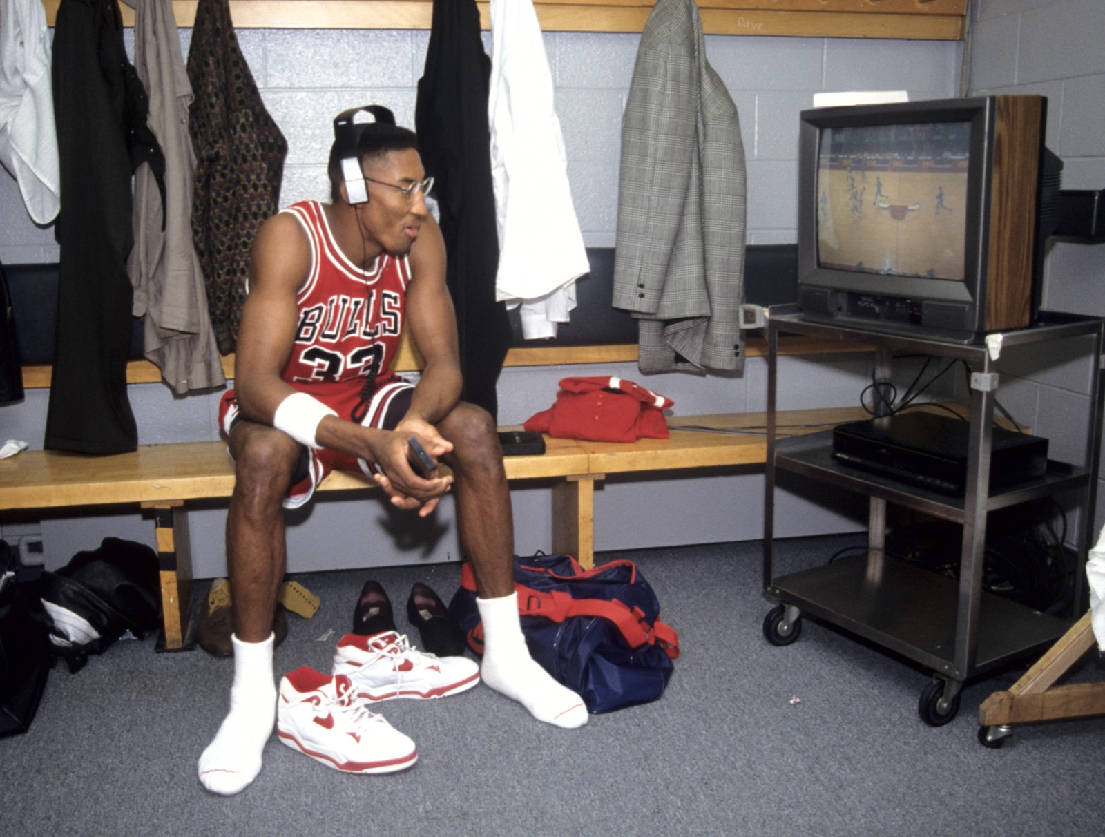 Pippen in the locker room watching TV with headphones on