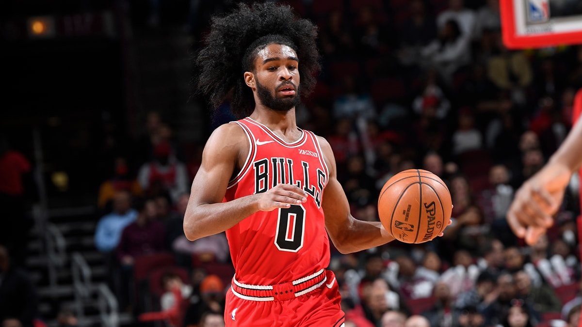 Coby White dribbling