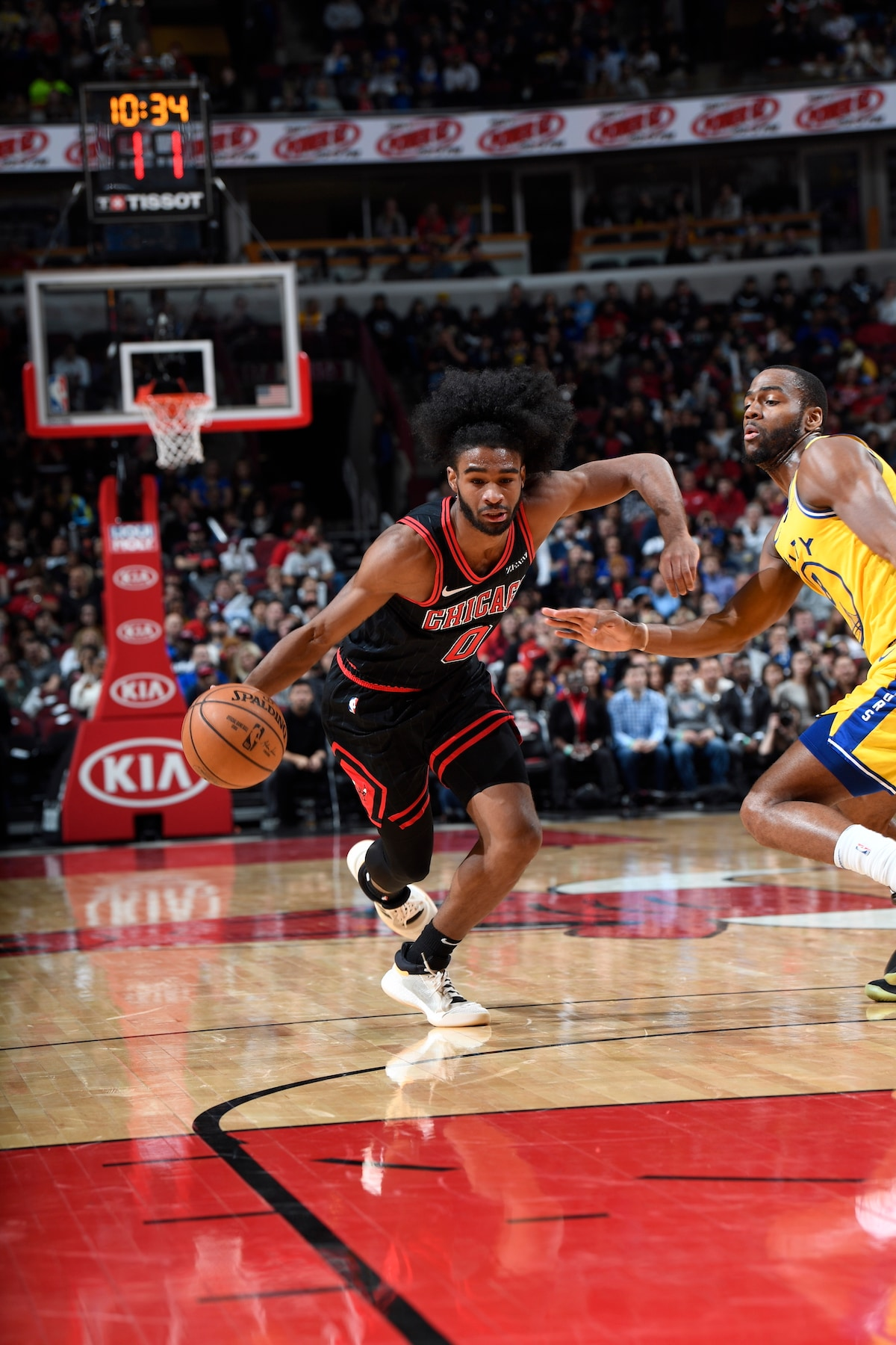 Coby White dribbles