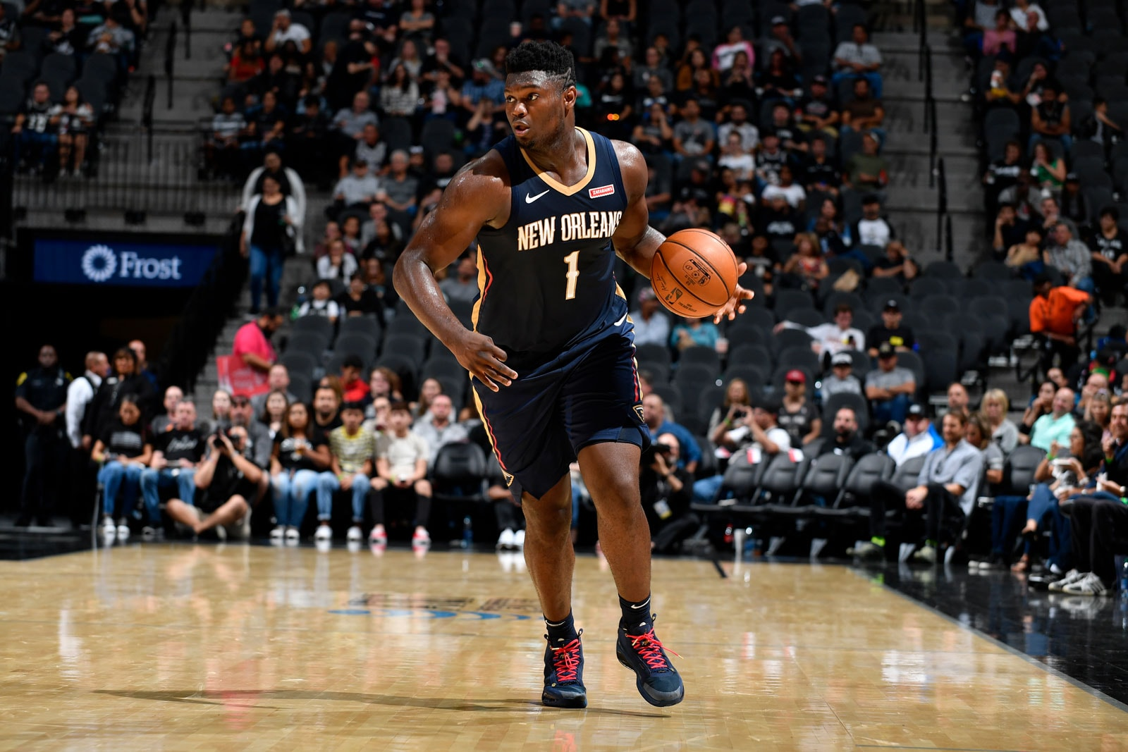 Zion Williamson #1 of the New Orleans Pelicans handles the ball against the San Antonio Spurs during a pre-season game on October 13, 2019 at the AT&T Center in San Antonio, Texas.
