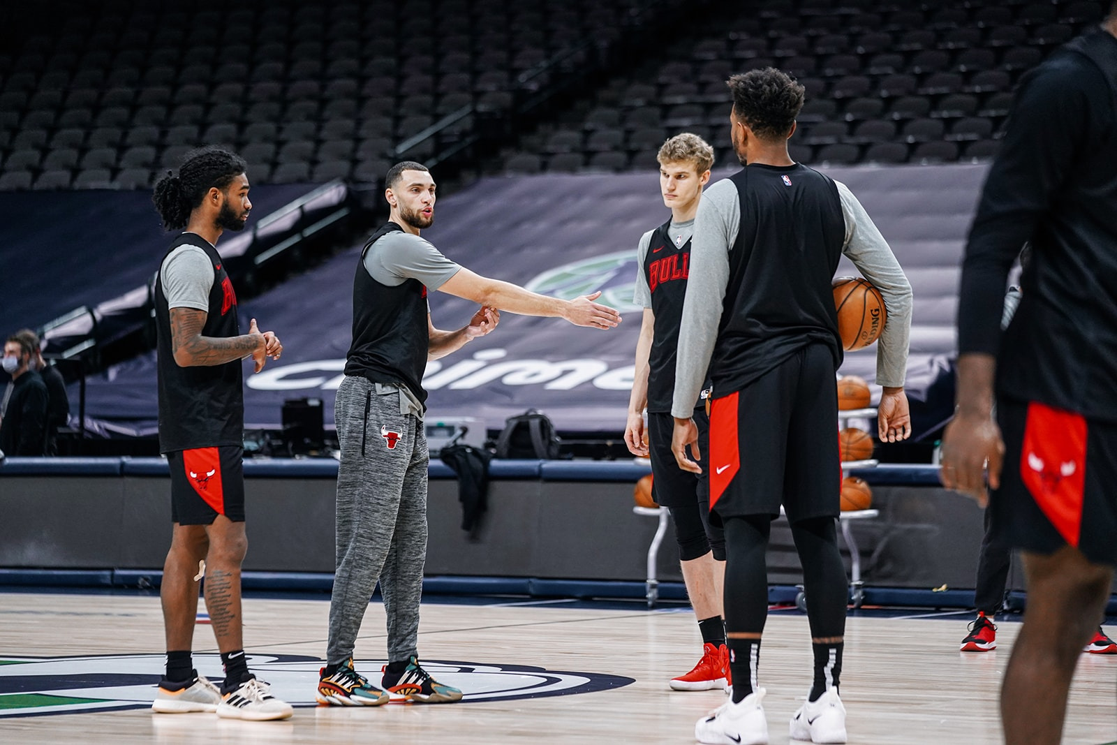 Zach talking to Coby, Lauri and Wendell in training