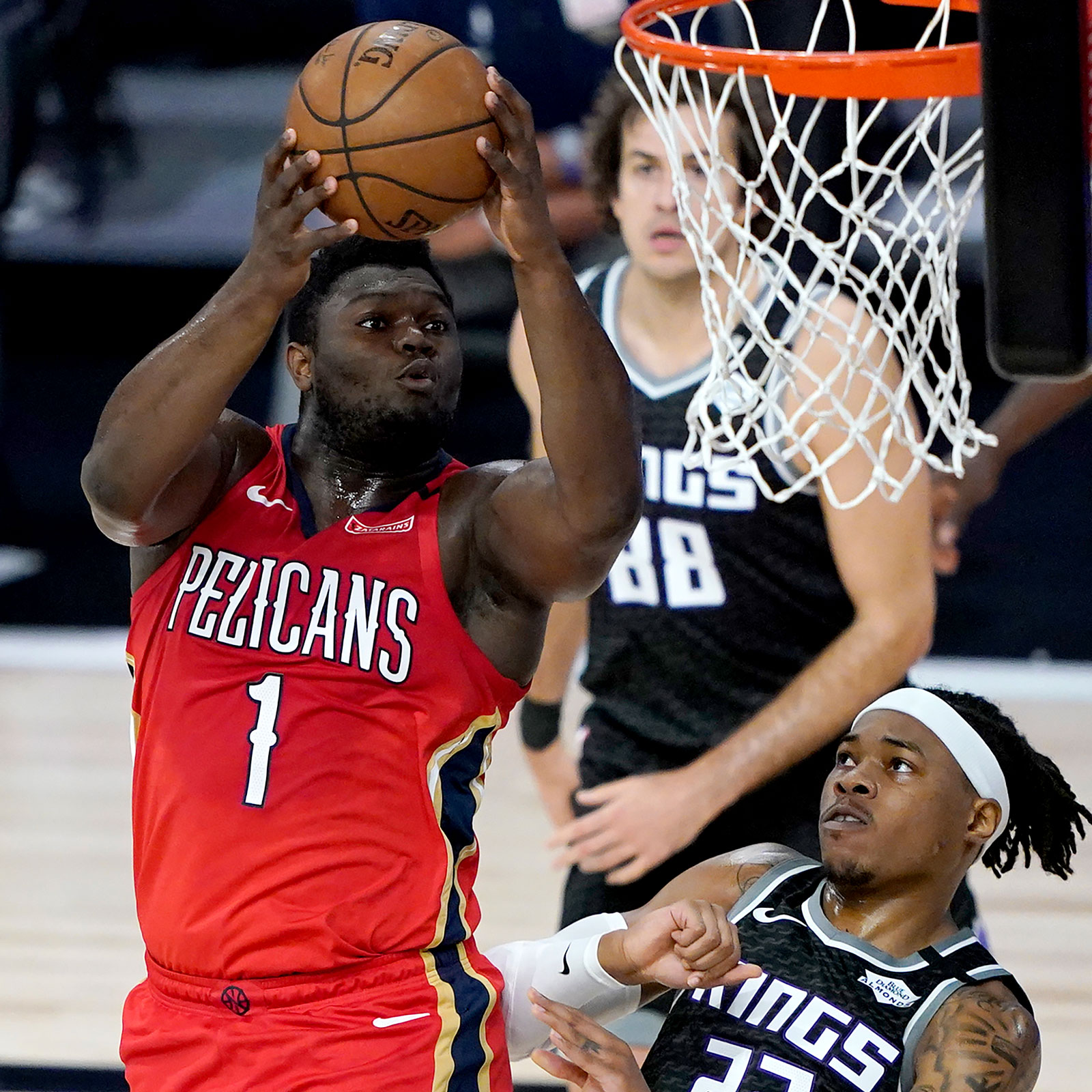 Zion Williamson #1 of the New Orleans Pelicans goes up for a basket against Richaun Holmes #22 of the Sacramento Kings during the first half of an NBA basketball game at HP Field House at ESPN Wide World Of Sports Complex on August 6, 2020 in Lake Buena Vista, Florida.