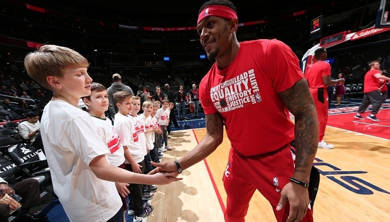 Bradley Beal greets kids before a game